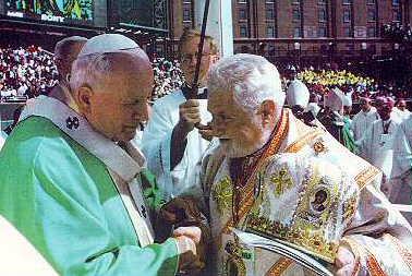 Photo of Pope John Paul and Bishop John Elya shaking hands